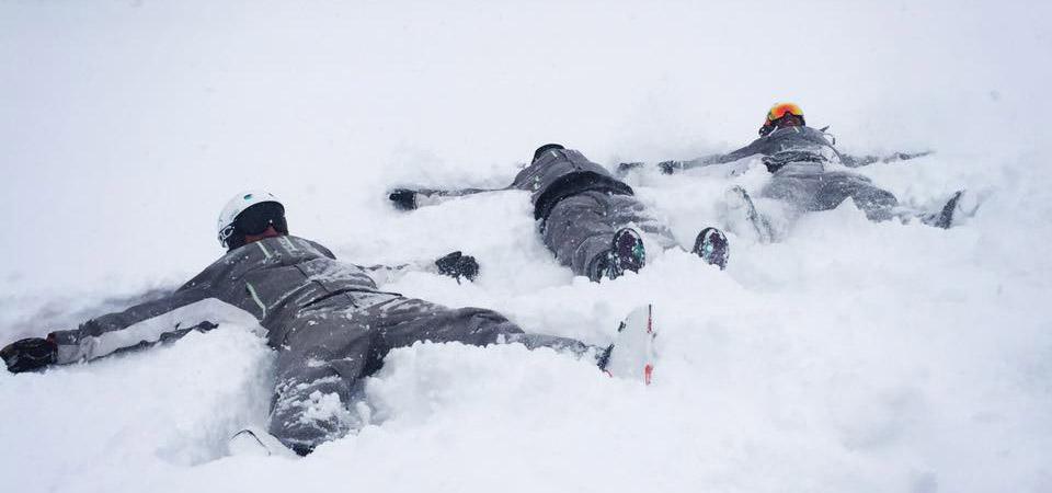Amade Ski Instructors making snow angels